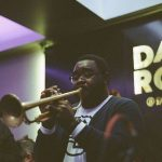 Brady Lewis plays trumpet at The Dark Room