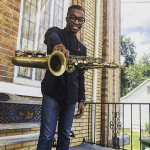 Scooter Brown, Jr. holding saxophone