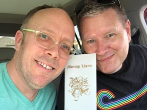 Matthew Kerns of St Lou Fringe and his husband with marriage license